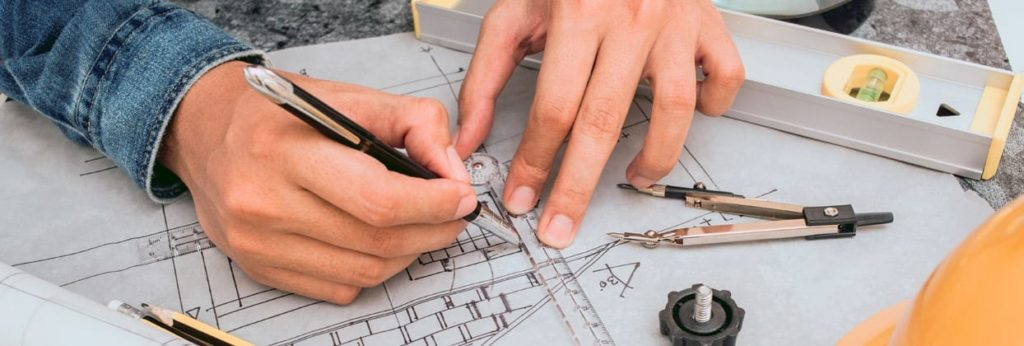 Draghtsman designing wooden windows on traditional paper with pen and ruler